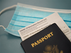facemask, US Passport, and Covid Vaccination Card